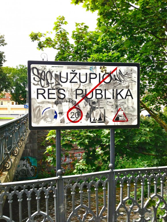 Sign by Bridge to Užupis