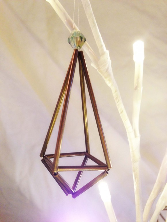 "Use longer straws fro two of the four sets of ""ears"" to make a teardrop shape. (This is an ornament I made using brass straws.)"