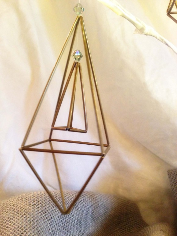 Here's a small three-sided ornament nested within a larger one.