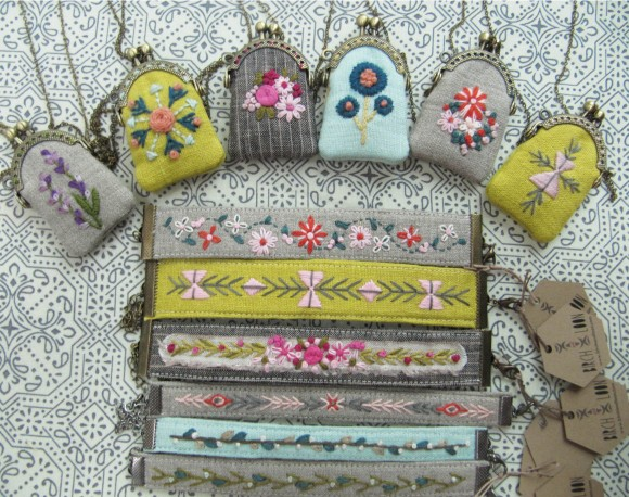 bracelets and mini coin purses on pattern background